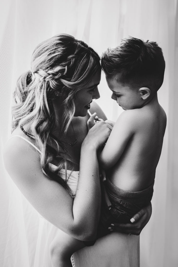 mother holding son maternity photo