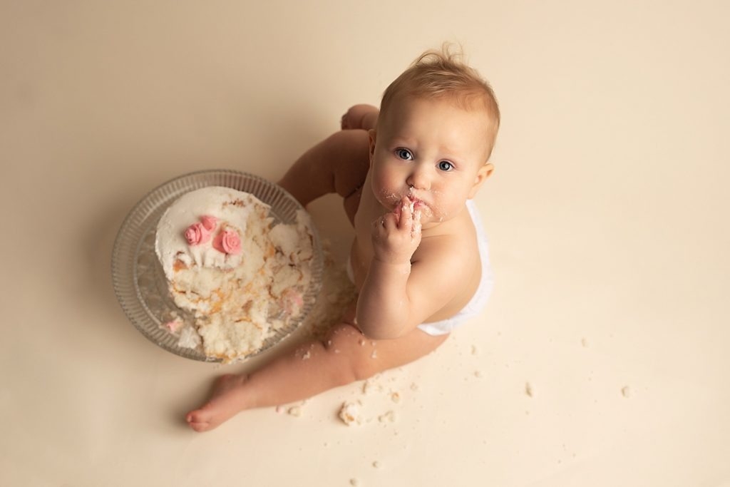 baby eating cake shot from above