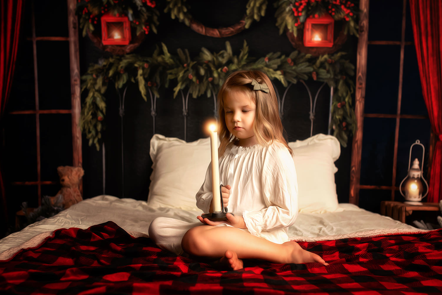 Rochester Christmas Mini Sessions - Child on bed with Candle at Christmas